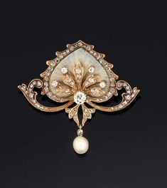 AN ART NOUVEAU DIAMOND, ENAMEL AND PEARL BROOCH The central translucent enamel stylised lotus leaf with applied old brilliant and rose-cut diamond spray and rose-cut diamond edging, supported by twin rose-cut diamond scrolls, suspending a single pearl, circa 1900, pearl untested