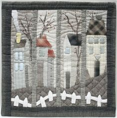 House quilt. Love the tall skinny houses with picket fences.