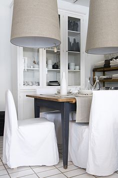 dining table with linen chairs