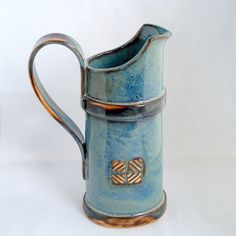 Hand built Blue pitcher, tying the handle into the band is a great idea