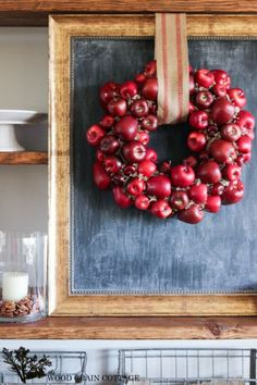 Fake apples lend themselves to create a striking, royally red wreath.  Get the tutorial at The Wood Grain Cottage.   - CountryLiving.com