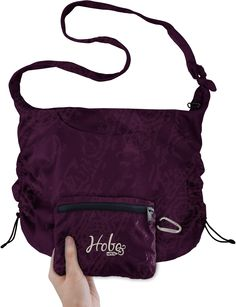 ChicoBag Hobo Shoulder Bag - adjusts from pretty small to pretty large.  Has a zipper on top to securely close it.  I used this as a crossbody town/evening bag and shopping bag.  Lightweight (3 oz.!) and somewhat stylish.  Can be carried at the same time as you are wearing your backpack, so I could easily use it as my carry on when I checked my backpack or when I put my pack in the luggage compartment of a bus. No longer available at REI, but can still be purchased directly from Chicobag.