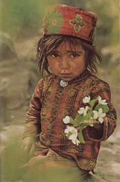 Pakistan | Girl in Shimshal, Upper Hunza || Image scanned from National Geographic November 1975. Article and Photographs by Sabrina and Roland Michaud