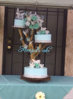 Butteflies quinceañera cake in tree stand. Visit us Facebook.com/marissa'scake or www.elmanjarperuano.com