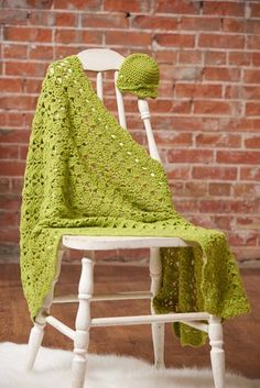 There's just something sweet about creating a handmade gift for baby. This blanket combines a light and airy shell with a solid wavy edge.Finished Size:  26