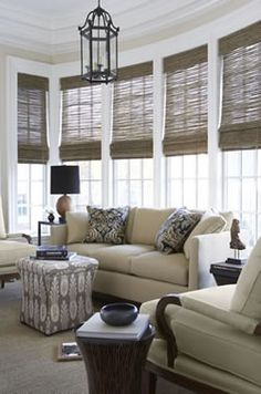 These woven shades really pull this room together, especially with the patterned ottoman and pillows
