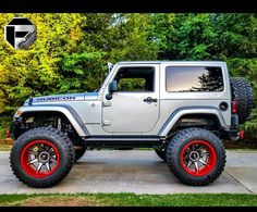 TWO DOOR SILVER RUBICON WITH CUSTOM LIFT AND NEW FUEL WHEELS