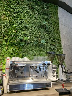 Setting up a coffee bar at the European Medcines Agency in Amsterdam in front of the largest plant wall in Europe! #coffee #cafe #espresso #photography #coffeeaddict #yummy #barista