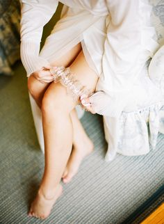 Pretty lace wedding garter by The Garter Girl   Katie Stoops Photography