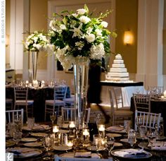 White roses, hydrangeas, Casa Blanca lilies, orchids, tulips, and agapanthus topped glass vases.