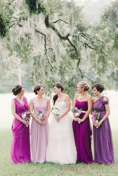 Purple and plum bridesmaid gowns - what do you think about mixing colours for your maids? // Michelle Lange Photography || Follow @ModernWeddingMagazine on Facebook #bridesmaids #weddings