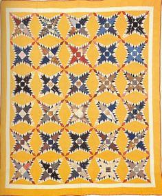 Pine Burr, 1898. Made by Lucretia Baumunk. Putnam Co, Indiana.  certainly a happy quilt!