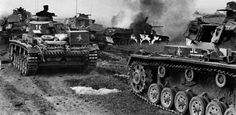 A platoon of tanks of the 11.Panzer-Division passes by a burning BT-7 Soviet tank during the Battle of Kiev. The leading tanks are Panzer IV Ausf. D and the following two are Panzer III Ausf. H.  The Germans achieved incredible feats of arms during Battle of Kiev. The envelopment of Kiev in September 1941 resulted in the capture of 665,000 prisoners.