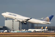 """aviationgreats:  """"A United 747 with some condensation above the wings upon departure.  """""""