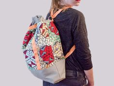 What can you make with less than 1.5m of material? A purse AND a backpack; two in one. You can make a backpack, with neat storage space inside, and Flcty shows you how to do both.