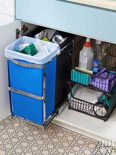 No more digging in the dark to find the bleach. Undersink cabinets are often a jumble of cleaning products, trash bins, and other practical household items. Take control of the mess using a pullout track for small trash and recycling bins and stackable wire baskets for other necessities. Trash And Recycling Bin, Trash Bins, Black Kitchen Cabinets, Black Kitchens, Kitchen Storage, Kitchen Sink Organization, Sink Organizer, Household Items, Under Sink