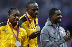 Medallists pose during the men's 100m victory ceremony at the London 2012 Olympic Games