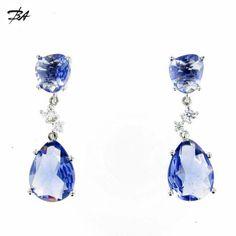 #Pendientes de #plata con circonitas y cuarzo iolitas, de color lila azulado,con un largo de 5cm.  VENTA ONLINE http://www.bienvenidoasensijoyeros.com/es/criollas/135-pendientes-plata.html