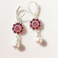 """Delicate 1.5"""" long with the pearl, 1"""" without - swarovski dangles. Choose either a silver plated ear hook, or lever back. MEMBER - Cindy's Arts"""