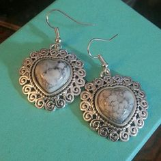 SALESilver stone earrings Silver heart shaped earrings with a natural stone.   ALL OFFERS CONSIDERED ⬇⬇⬇use the offer button⬇⬇⬇ Trades Paypal Jewelry Earrings