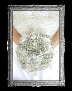 White & Silver Wedding Brooch Bouquet--too much bling for my taste, but tone it down a bit and it'd be pretty.