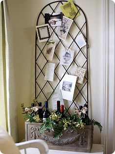 Garden trellis card display with wine bottles....great for Christmas, adult birthday decor as well as a wedding reception.