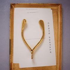 Brass wishbone paperweight