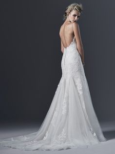 Sottero and Midgley - SANDRINA, Stunning simplicity is found in this embroidered lace and tulle wedding dress with slim A-line skirt. Elegant spaghetti straps give way to a daring; plunging back; edged with lace appliqués. Finished with V-neckline and covered buttons over zipper closure.