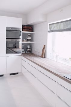 Corner. White kitchen with a wooden worktop