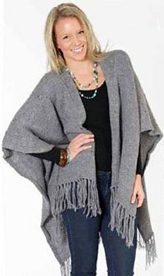 One-size wool poncho wrap is made with two large knitted rectangles, then adding a fringe and simple crocheted border.