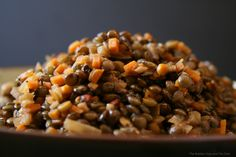Easy, yummy lentils. I halved the recipe and used half chicken stock, half water. I added 3 teaspoons of indian spice mix while cooking. Really good!