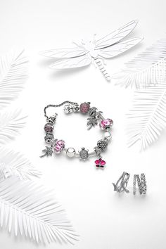 Create a vibrant bracelet in silver and pink! PANDORA's orchid dangle charm, illustrated in sterling silver and embellished with hand-applied enamel and hand-set sparkling stones, is the perfect centrepiece. The delicate and graceful flower is the most coveted of exotic plants, representing love, beauty and strength.