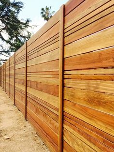 Aanco Fence - Spring Valley, CA, United States. B-grade w/canyon brown stain... Custom horizontal pattern...