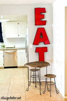 Adorable EAT sign and kid's table in the kitchen | www.classyclutter.net