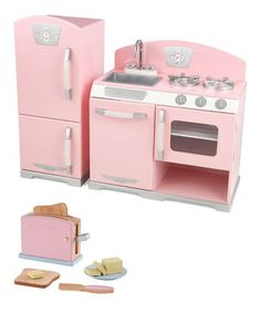 Young chefs serve the best dishes from this interactive play kitchen and toaster set. Featuring an easily cleaned removable sink, appliances with knobs that turn and click, and doors that open and close, this kitchen invites multiple children to cook together in an exciting and educational environment. Plus, the toaster with pop-up handle and breakfast accessories allow little ones to make two buttered slices of toast.
