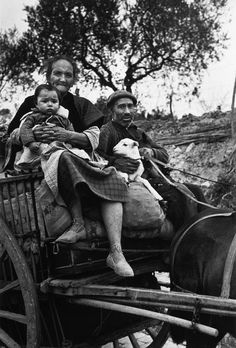 Near Tarragona, Spain. On the road from Tarragona to Barcelona. People from Tarragona seeking refuge in Barcelona, before the evacuation of the city. Many of them were killed or lost their belongings during fascist air raids. By Robert Capa, (January 15th, 1939)