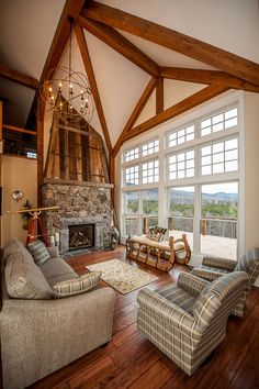 Beautiful exposed beams and tall windows? Yes, please.  Cabot Barn Yankee Barn Homes Design