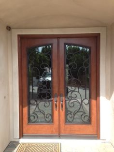 Jeld-Wen IWP Custom Wood Double Entry Door with Iron Grilles & Krosswood Knotty Alder Double Entry Door with wrought iron grilles ... pezcame.com