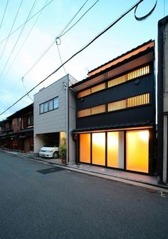kyoto-town-house-japan. Great facade design. Grils mixed with big window design. Townhouse facade.