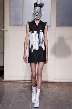 Maison Martin Margiela Spring 2013 Couture - Style.com    Raw look of painted canvas. Puff shoulders look to be crafted by rolling back the fabric into exaggerated piping.