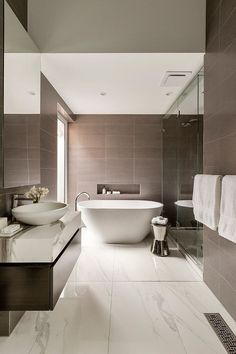 Modern Bathroom modern bathroom features a bold mixture of bright natural wood from flooring tiles to floating Marble Vanity In The Bathroom Adds To The Opulence