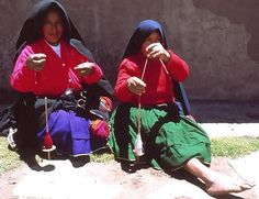 Unusually, where most country women in Peru wear hats, the women of Taquile island on Lake Titicaca--two busily spinning here--wear mantas (shawls) over their heads