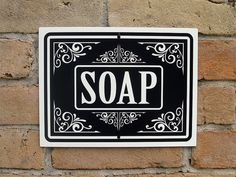 Soap Sign  12x9 inches. (22.9 x 30.5 centimeters)  This sign was made using vinyl art that was hand applied on to gloss white anodized aluminum. The corners have been filed smooth to remove sharp edges. Sign includes a hole on top and bottom for easy hanging.  Ships Priority Mail within the United States 1-3 Business Days after Purchase! International Orders Ship First Class. Combine shipping when you buy multiple signs! Thanks