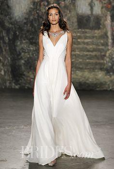 A draped V-neck Jenny Packham with chest embellishment | Brides.com