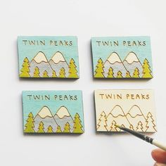Love these! regram @wrenandwilson This morning I have mostly been painting Twin Peaks signs  these little guys will be up in the shop next week!  . . . #twinpeaks #handmade #illustration #pinbadge #forest #lasercut #davidlynch #art #painting #design #pingame #fun #etsy #etsyseller #smallbusiness #signage #sign #coolstuff #handdrawn #handdrawntype #mountains #outdoors #TV