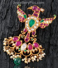 Peacock shaped pendant with rubies and emerald - Latest Jewellery Designs