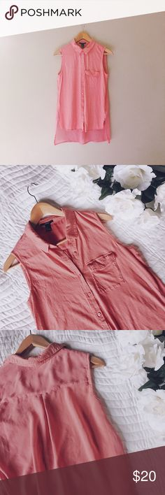 Forever 21 Sheer Back Sleeveless Blouse This is a gorgeous summery Top for work or for casual occasions! It's salmon colored, kind of an orange-pink. It's really nice because the back is Sheer, which I especially love! It's in excellent used condition. Forever 21 Tops Blouses