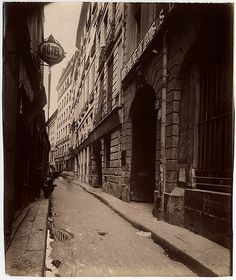 Digital Accession Number: 1981:0952:0032.0001 Maker: Eugène Atget (French, 1857-1927) Title: Le Rue Quincampoix - Vue prise de la Rue des Lombards (4e) Date: 1908 Medium: albumen print Dimensions: 21.5 x 17.8 cm. (trimmed) George Eastman House Collection General – information about the George Eastman House Photography Collection is available at www.eastmanhouse.org/inc/collections/photography.php. For information on obtaining reproductions go to: www.eastmanhouse.org/flickr/index.ph...