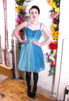 Was: £35.00  Now: £26.25    Size: 10    Vintage Blue Cocktail Prom Dress  Gorgeous 70's strappy mini dress in light blue and turquoise coloursways with net underskirt to create that cute puffball skirt effect. Other features include; chiffon-like fabric fades from more...  Condition: Vintage  Vintage Era: 1970s  Colour: Blue