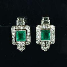 A pair of art deco emerald and diamond earrings circa 1925.